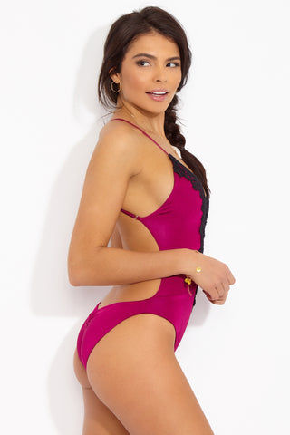 BLUE LIFE Eclipse One Piece Swimsuit - Black Dahlia One Piece | Black Dahlia| Blue Life Eclipse One Piece Magenta one piece with black lace trim along the deep plunging neckline. High cut leg. Adjustable criss cross spaghetti straps. Ruching on the back. Cheeky coverage.