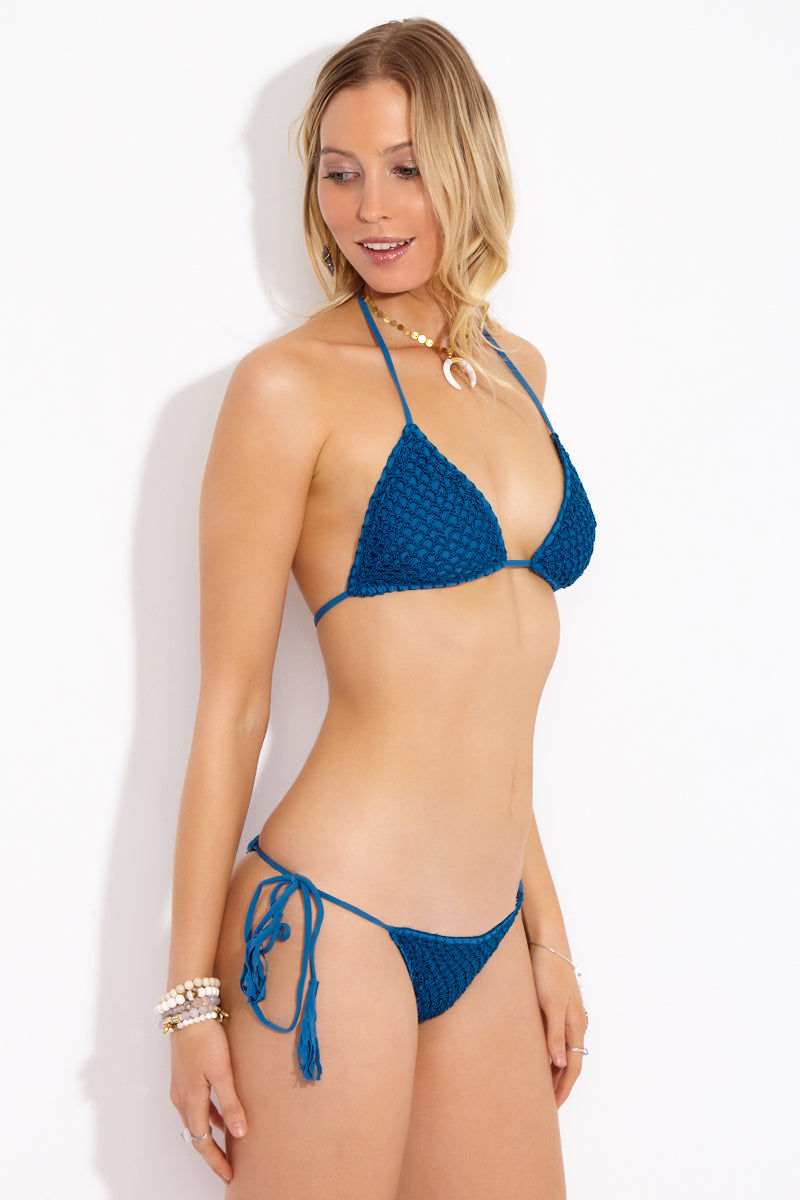 ACACIA Humuhumu Triangle Bikini Top - Salt Water Bikini Top | Salt Water| Acacia Humuhumu Triangle Bikini Top - Salt Water Front View Triangle bikini top in deep sea blue fabric. Crochet overlay. Adjustable ties at neck and back. Double lined in Acacia's signature snakeskin print fabric. View: Side View.