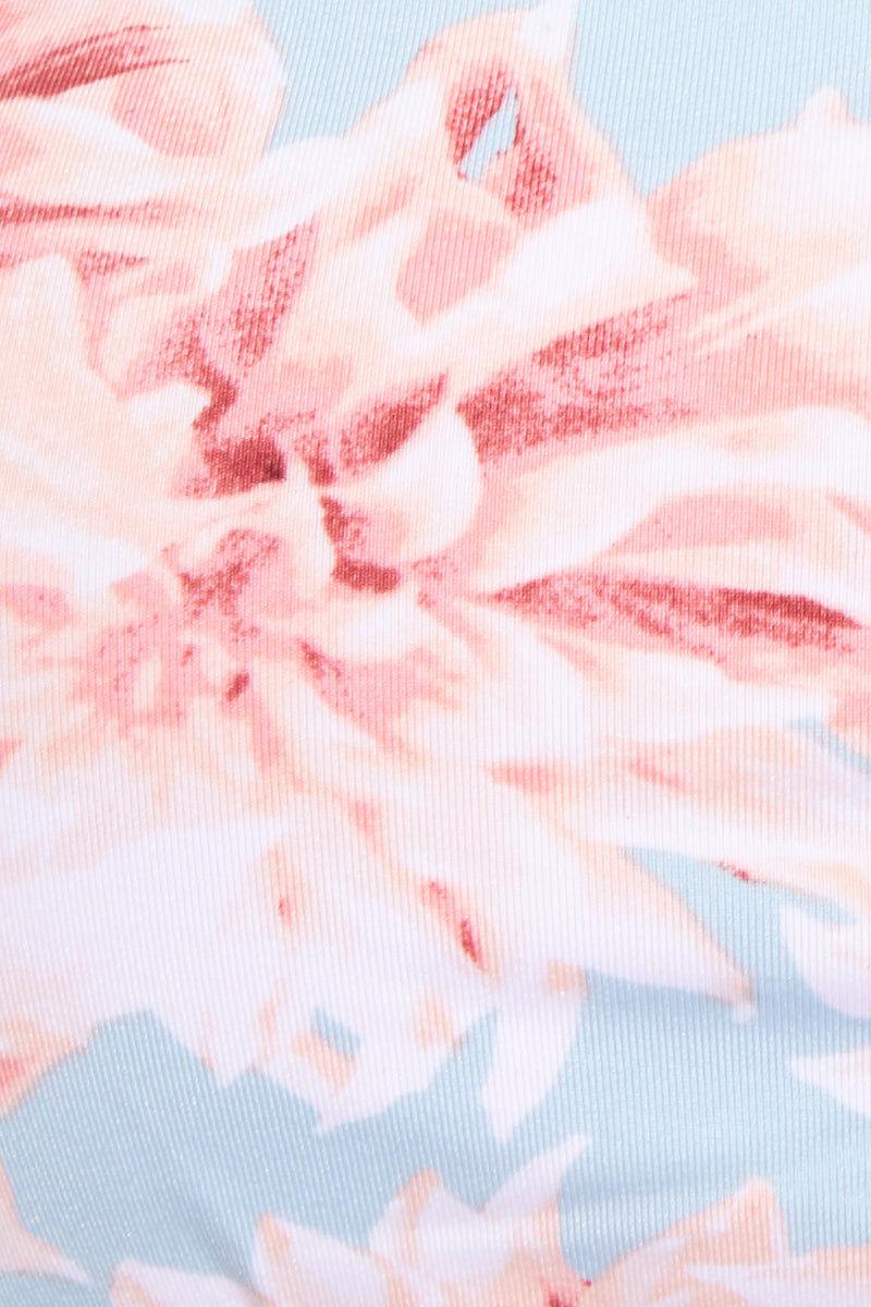 FRANKIES BIKINIS Joy Bottom - Wild Flower Bikini Bottom | Wild Flower| Jaymi Bottom Detail View Brazilian Cut Skimpy Bikini Bottom Light Blue Fabric Pink and White Wildflower Print Spaghetti Side Straps Rose Gold Ring Accents Low-Rise Cut Brazilian Coverage