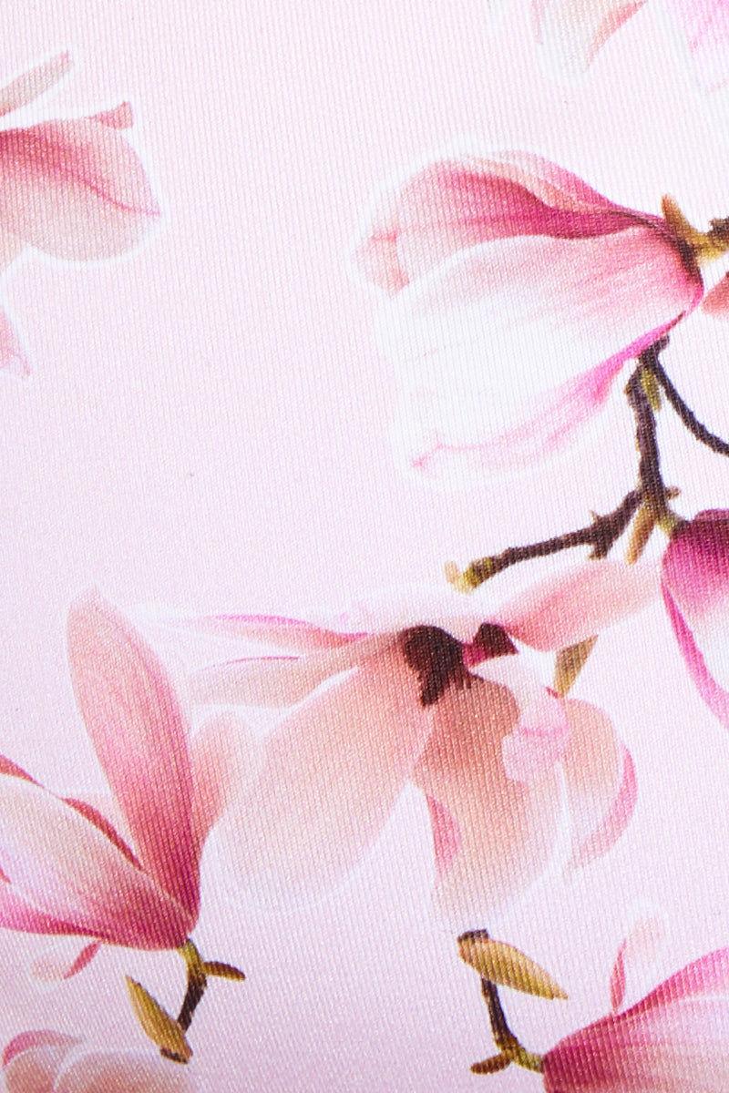 FRANKIES BIKINIS Whitney Top - Sakura Bikini Top | Sakura| Whitney Top Detail View White Fabric Pink Cherry Blossom Print Bikini Top Peekaboo Bust Cut Out Scoop Neckline Thin Shoulder Straps Strappy Crisscross Back