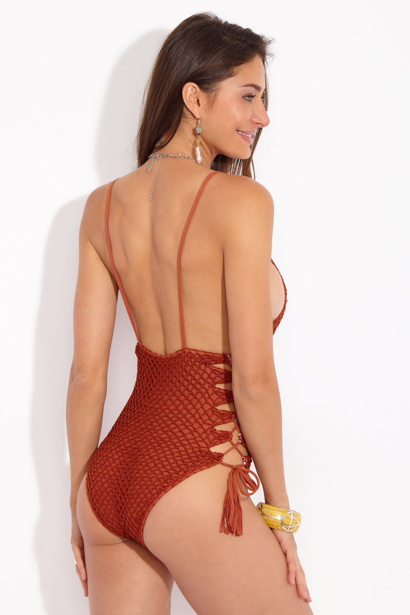 ACACIA Florence  Lace Up Sides One Piece - Mai Tai One Piece | Mai Tai| Acacia Florence Lace Up Sides One Piece - Mai Tai Back View Rust red-orange-brown one piece swimsuit with crochet overlay. Low scoop neckline. Thin spaghetti shoulder straps. Adjustable lace up sides. Low back. Cheeky to moderate coverage.
