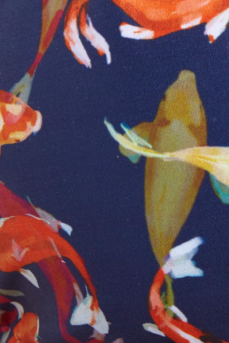 VERDELIMON Tunas Moderate Bottom - Koi Fish Bikini Bottom | Koi Fish| Verdelimon Tunas Moderate Bottom - Koi Fish Classic bikini bottom. Navy blue fabric offset by multicolor koi fish print. Medium wide straps. Moderate coverage.