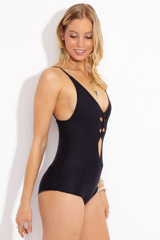 ACACIA Kokomo Strappy One Piece Swimsuit - Black Beauty One Piece | Black Beauty| Acacia Kokomo Strappy One Piece Swimsuit - Black Beauty, Features:  Black one piece swimsuit with perforated mesh overlay. Strappy cut outs on torso. Low scoop neckline. Spaghetti straps. Strappy cut outs at the back. Moderate to full coverage. View: Side View.