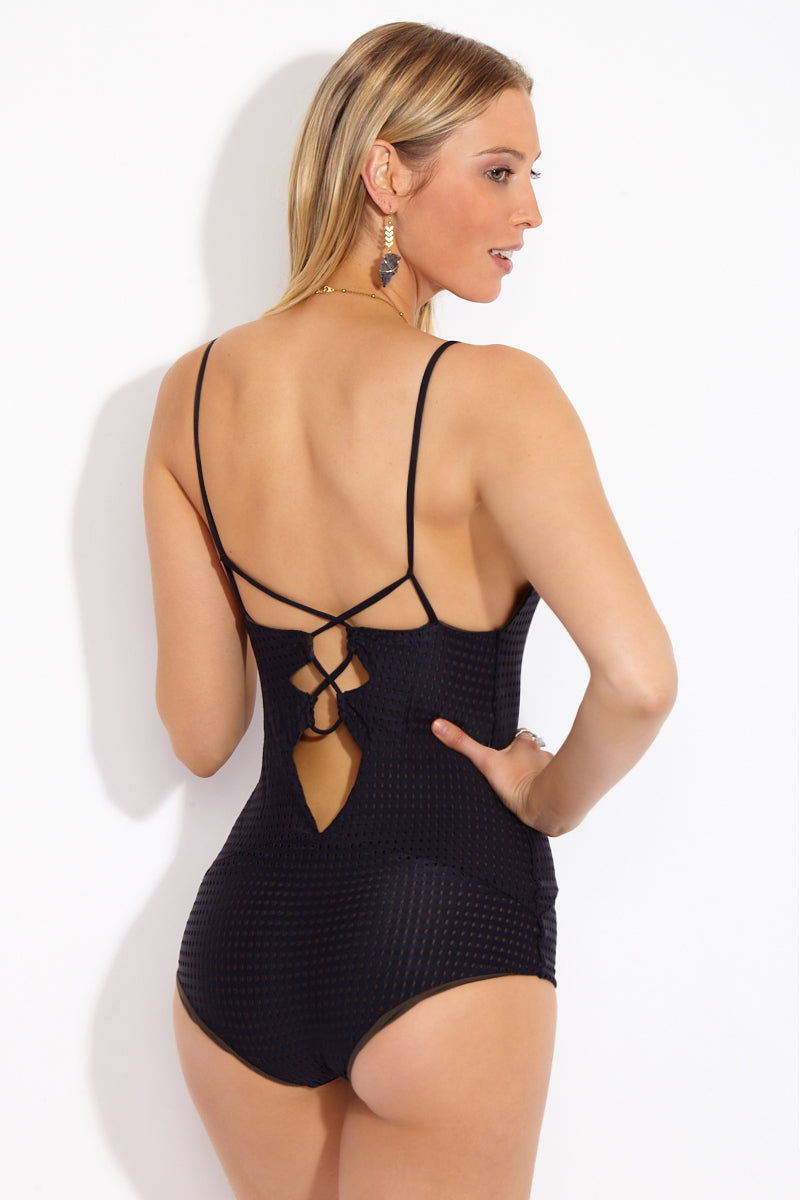ACACIA Kokomo Strappy One Piece Swimsuit - Black Beauty One Piece | Black Beauty| Acacia Kokomo Strappy One Piece Swimsuit - Black Beauty, Features:  Black one piece swimsuit with perforated mesh overlay. Strappy cut outs on torso. Low scoop neckline. Spaghetti straps. Strappy cut outs at the back. Moderate to full coverage. View: Back View.
