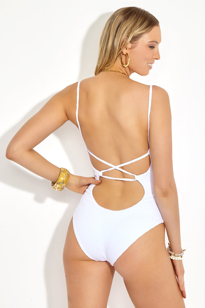 FELLA Zac Strappy Back One Piece Swimsuit - White One Piece | White| Zac One Piece Back View. Sultry white scoop neck one piece swimsuit in on-trend textured finish. Stretchy fixed spaghetti straps criss-cross over deep open back in sexy corset-like pattern. High-quality Italian Lycra fabric with on-trend texturing adds dimension to the one piece swimsuit. Lower cut legs and subtly cheeky rear give you moderate to full coverage overall.
