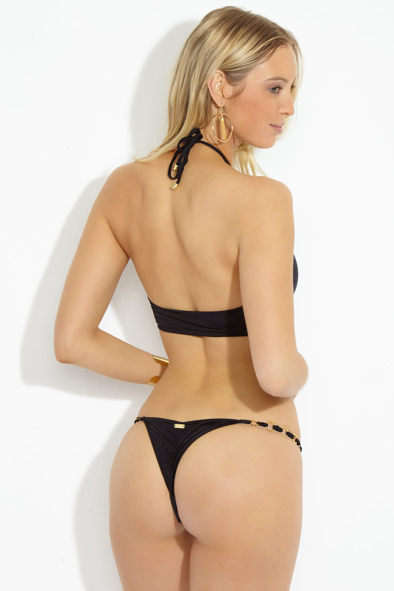 BEACH BUNNY Ireland Tango Ring Cheeky Bikini Bottom - Black Bikini Bottom | Black| Beach Bunny Ireland Tango Ring Cheeky Bikini Bottom - Black Back View String side black bikini bottom Very minimal coverage Cheeky to almost thong style Adjustable side string