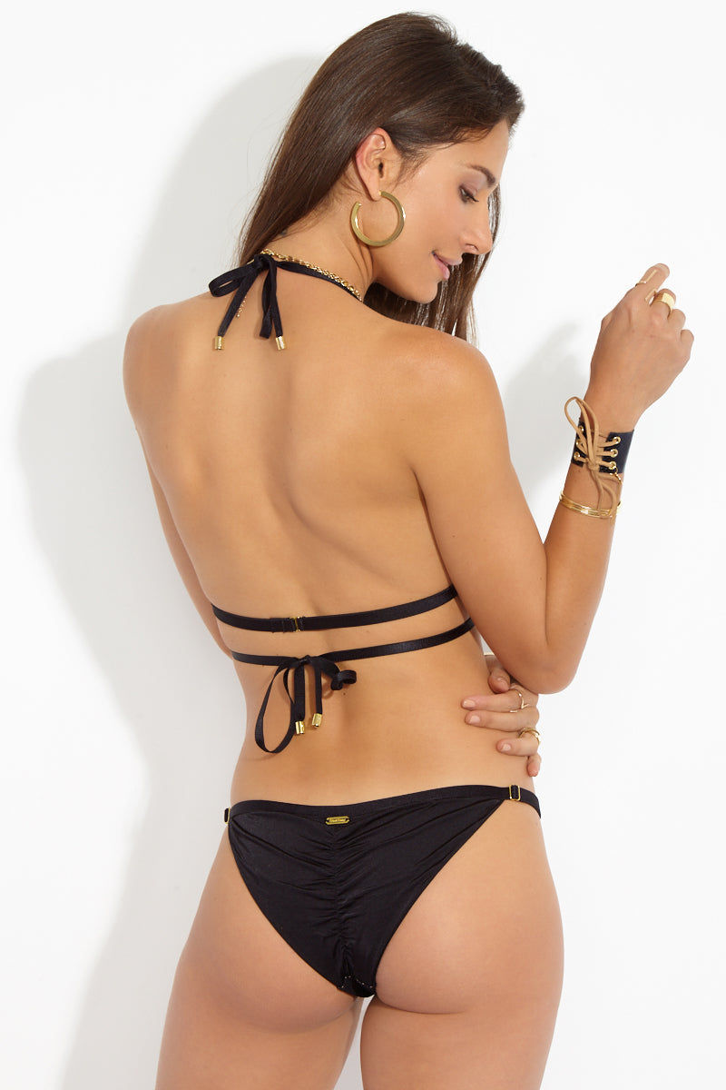 BEACH BUNNY Ava Mesh Low Rise Bikini Bottom - Black Bikini Bottom | Black| Beach Bunny Ava Mesh Low Rise Bikini Bottom - Black. Low-rise black bikini bottom in edgy mesh. Fully lined in nude fabric so the see-through look is only an illusion. Adjustable skinny side straps give the bikini bottom a sexy strappy finish. Back View