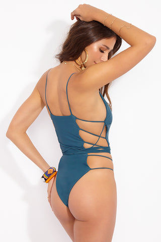 MIA MARCELLE Michon Lace Up Sides One Piece Swimsuit - Teal One Piece | Teal|Michon One Piece - Features:  Plunging V Neckline  Strappy Sides  Adjustable Wrap Around Tie Detail with Beaded Accents  High Cut Leg  Thong-Skimpy Coverage
