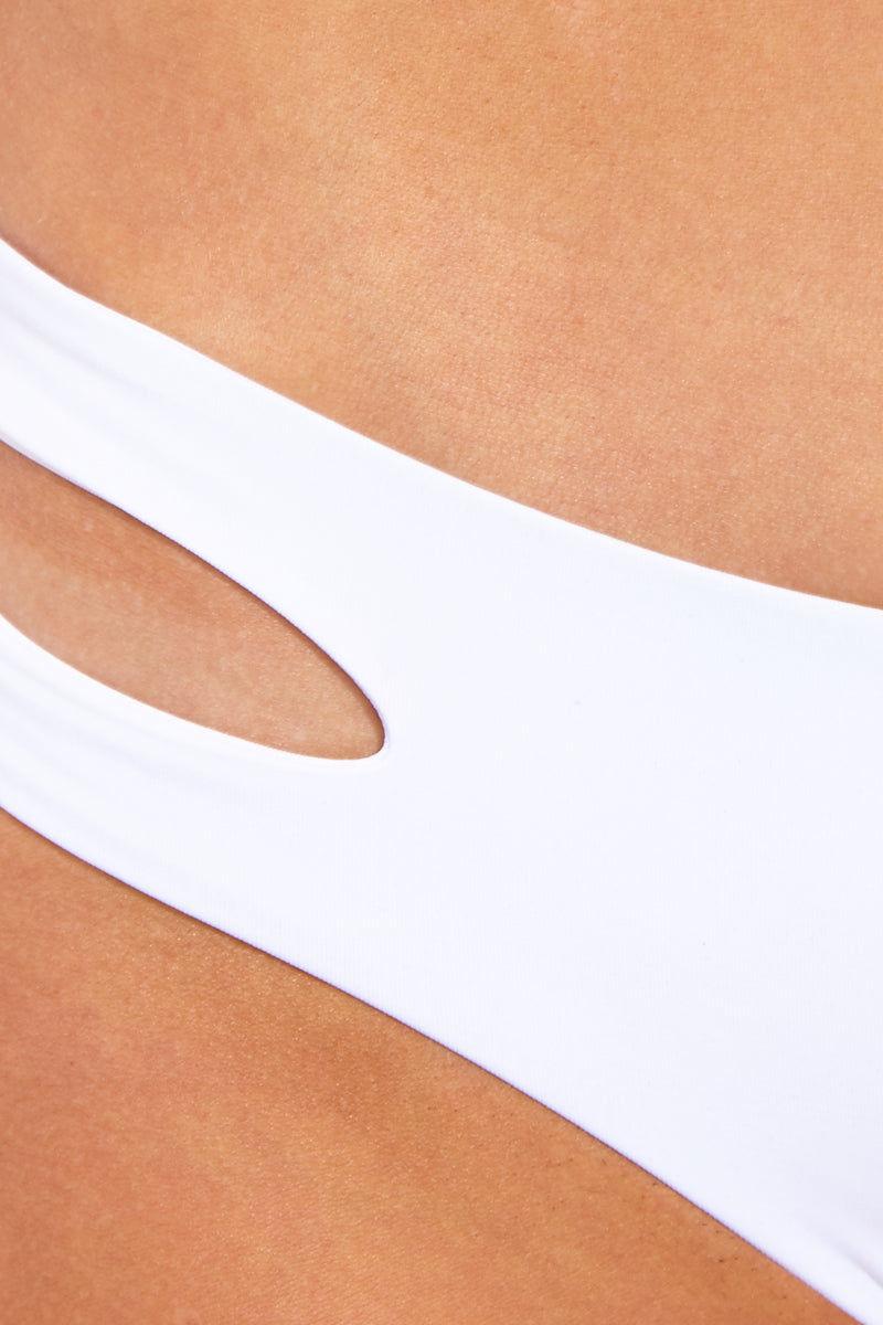 L SPACE Estella Bikini Bottom - White Bikini Bottom | White| L Space Estella Bikini Bottom Detail Fabric View White Hipster Style Bikini Bottom Low-Rise Cut Side Cut Outs Moderate Coverage
