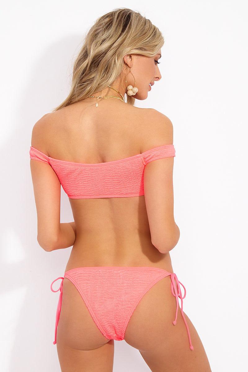 L SPACE Lily Bikini Bottom - Neon Pink Bikini Bottom | Neon Pink| L Space Lily Bikini Bottom Back View Tie Side Bikini Bottom Low-Rise Cut Adjustable Side Ties Cheeky Coverage