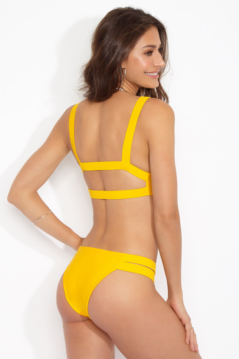BLACK BEACH Rockway Full Top - Gold Bikini Top | Gold|Rockway Full Top Features:  Yellow high neck bikini top Cut out strappy back detail Vibrant yellow gold color