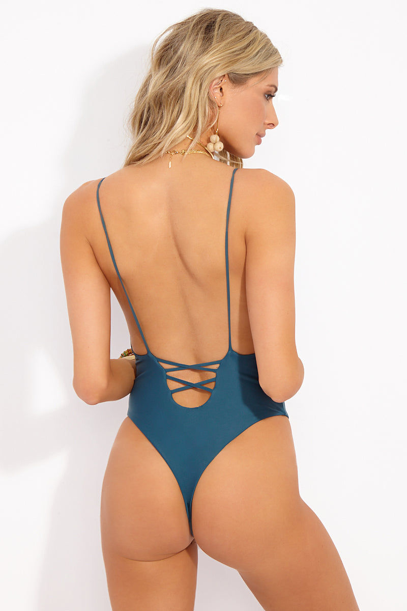 MIA MARCELLE Lola High Cut One Piece Swimsuit - Teal One Piece | Teal|Lola One Piece - Features:  Teal color minimal coverage One piece Scoop back with lace up style criss cross string detail String strap High leg cut Thong style back