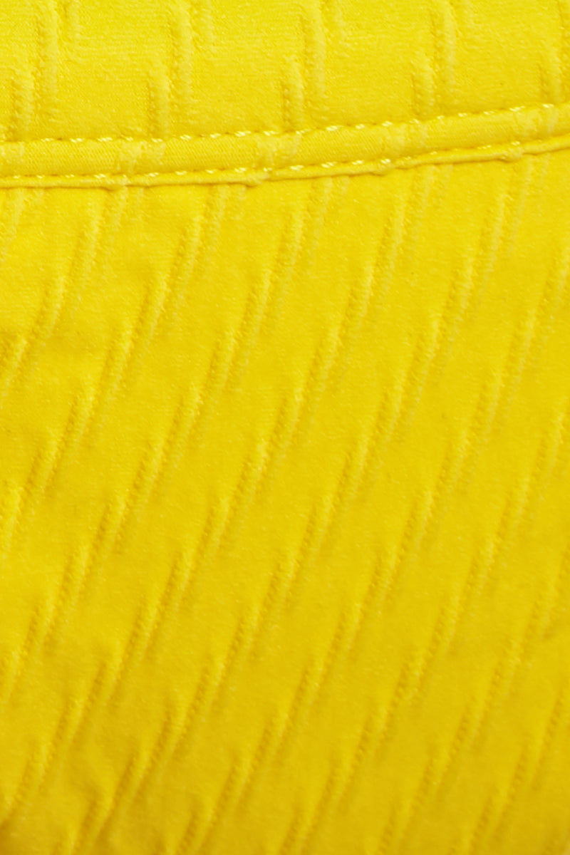 FELLA Logan Triangle Cut Cheeky Bikini Bottom - Lemon Bikini Bottom | Lemon|Logan Bottom Detail View Features:  Italian Textured Fabric Classic tanning cut bottom with thin binded sides This best seller features a cheeky cut bum Suitable for girls with both curves and a more tom boy figure