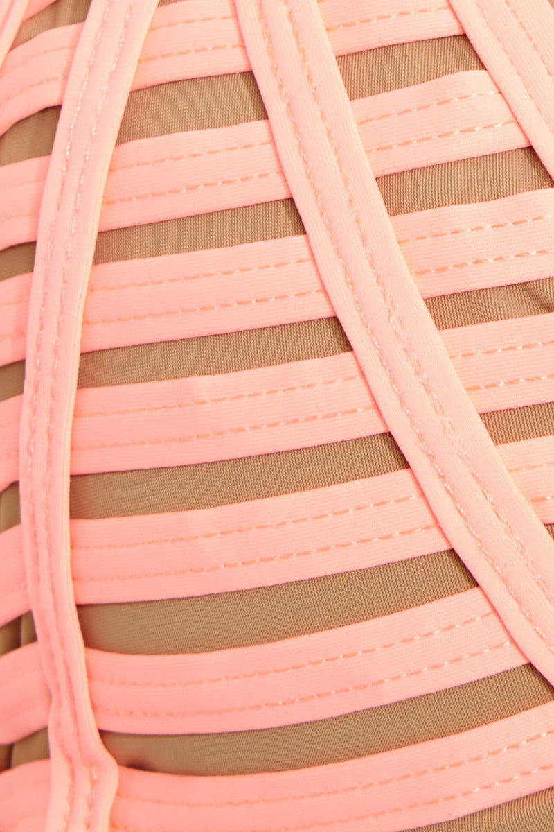BEACH BUNNY Hard Summer Triangle Bikini Top - Lt. Coral Bikini Top   Lt. Coral  Beach Bunny Hard Summer Triangle Bikini Top - Lt. Coral. Fabric Detail View. Triangle Top. Halter Neck Tie. Strappy binding is fully lined with nude fabric. Ties at center back.