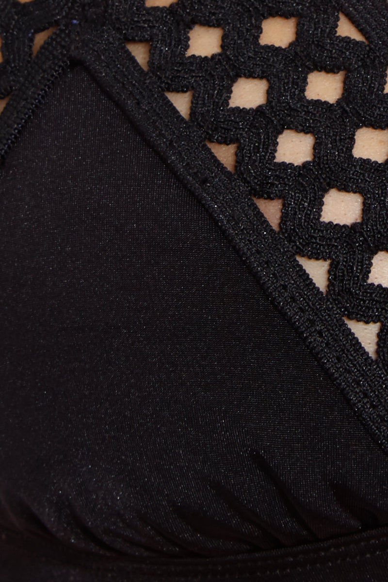 BEACH BUNNY Hayden Tango Cut Out Bikini Bottom - Black Bikini Bottom | Black| Beach Bunny Hayden Tango Cut Out Bikini Bottom - Black. Fabric Detail View. Features a Black Lattice cut out trim on the hips. Bottom is very skimpy coverage. Black elastic lattice side band. Brazilian/thong back coverage.