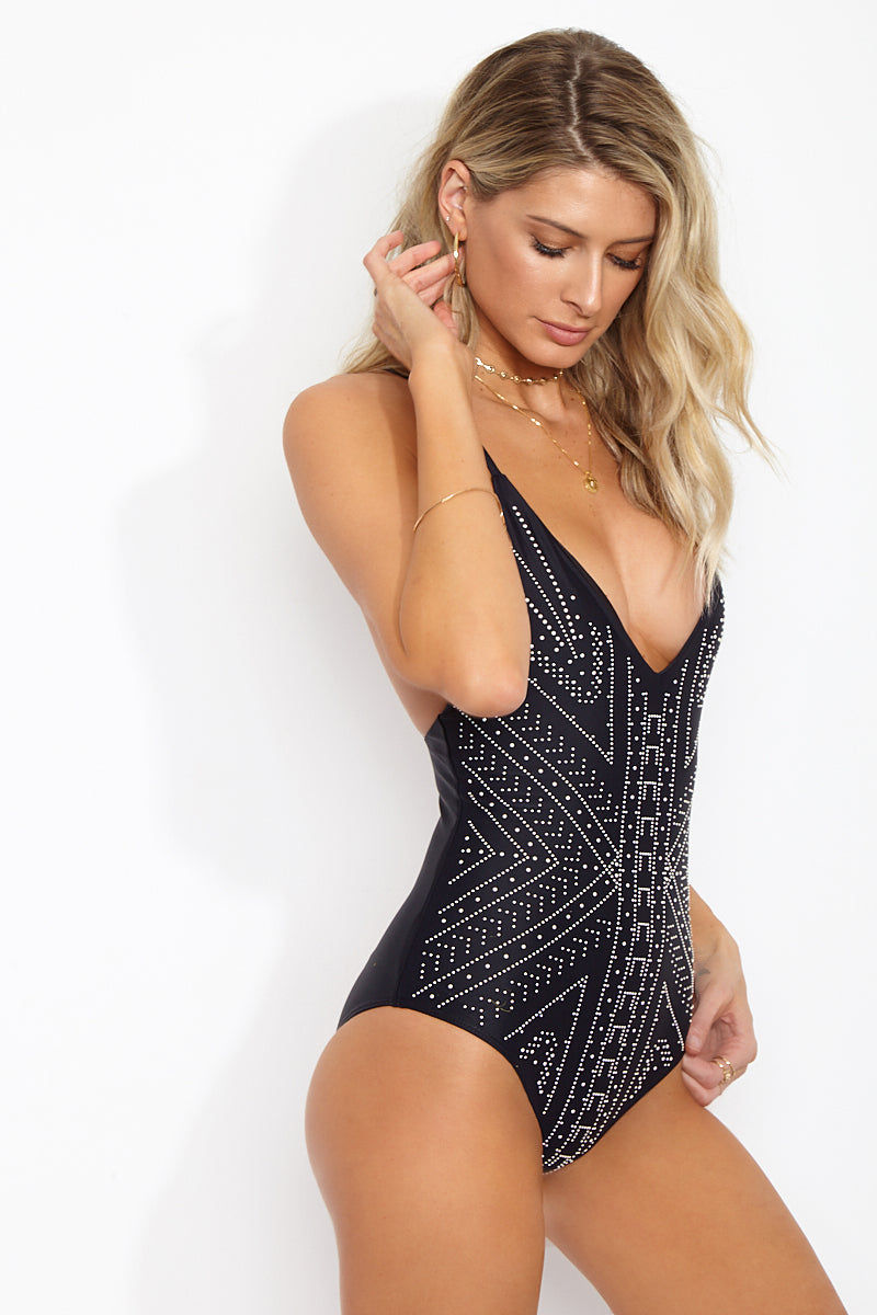 BEACH RIOT Bridget Beaded Deep V One Piece Swimsuit - Metallic Black Moon One Piece | Metallic Black Moon| Beach Joy Bridget Beaded Deep V One Piece Swimsuit - Metallic Black Moon. Features:Edgy and ultra-sexy deep-v low back beaded one piece swimsuit in classic black Intricate silver beaded detail at the front is strategically placed in a flattering abstract design to sculpt and slim your figure. View:  Side