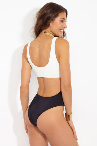 SOLID & STRIPED The Natasha Central Cutout One Piece Swimsuit - Cream/Black One Piece | Cream/Black| Solid & Striped The Natasha Central Cutout One Piece - Cream/ Black Front View Wide Scoop Neckline  Thick Shoulder Straps Can Be Worn Off Shoulders Center Cutout High Cut Leg  Cheeky Coverage
