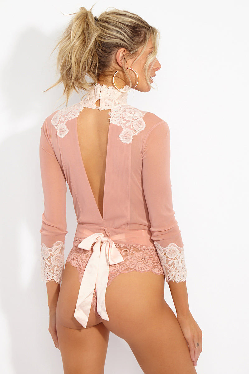 WE ARE HAH Multi-Way Take HAH Bow Thong Bodysuit - Copper/Rosé Bodysuit | Copper Rose Combo| Hot As Hell Reversible Take Hah Bow Bodysuit - Copper Rose Combo Back View   Can Be Worn Front or Back Long Sleeves Turtleneck with Button Closure  Satin Sash Cinches  Tie Bow Front Or Back  Cheeky Lace Brief  Fully Lined