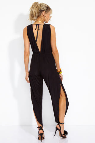WE ARE HAH Michele HAH Belle Capri Jumpsuit - Noir Jumpsuit | Noir| Hot As Hell Michele Hah Bell Jumpsuit - Noir Back View  Deep V Front & Back  Back Tie Closure  Essential Deep Pockets  Elastic Waist Loose Fitting Pant Legs Side Slits  NAUGHTY KNIT: 90% Polyester, 10% Spandex