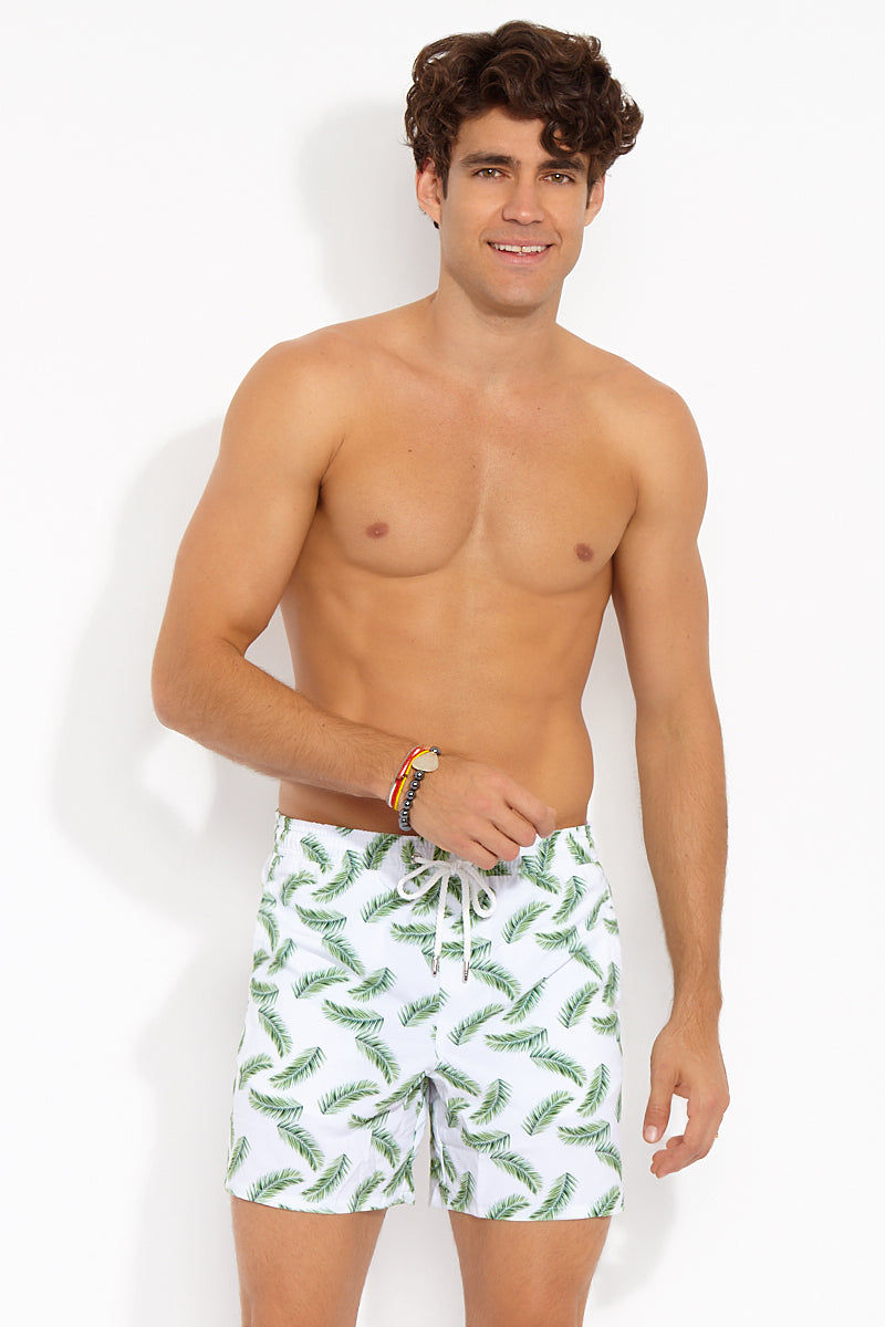NIRVANIC SWIM MEN Riki Mid Length Swim Trunks - Palm Leaf Print Mens Swim | Palm Leaf Print| Nirvanic Swim Men Riki Mid Length Swim Trunks - Palm Leaf Print Front View Drawstring Swim Trunks Elastic Waistband Side & Back Pockets Mesh Lining 16 in Length  Instant Dry Technology  Polyester  Wash in the waves | Dry in the shade  Made in Colombia