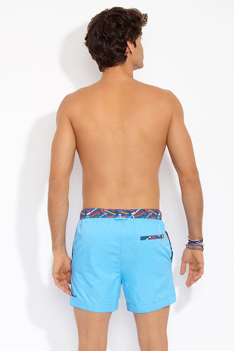 STTARWISH Ula Classic Length Swim Trunks - Aqua Blue Red Pop Art Mens Swim | Aqua Blue Red Pop Art| Ula Classic Length Swim Trunks - Aqua Blue Red Pop Art. BACK View. Classic length. Two side angle pockets. Zip pocket at back. Drawstring waist. Mesh net lining. Quick Drying.