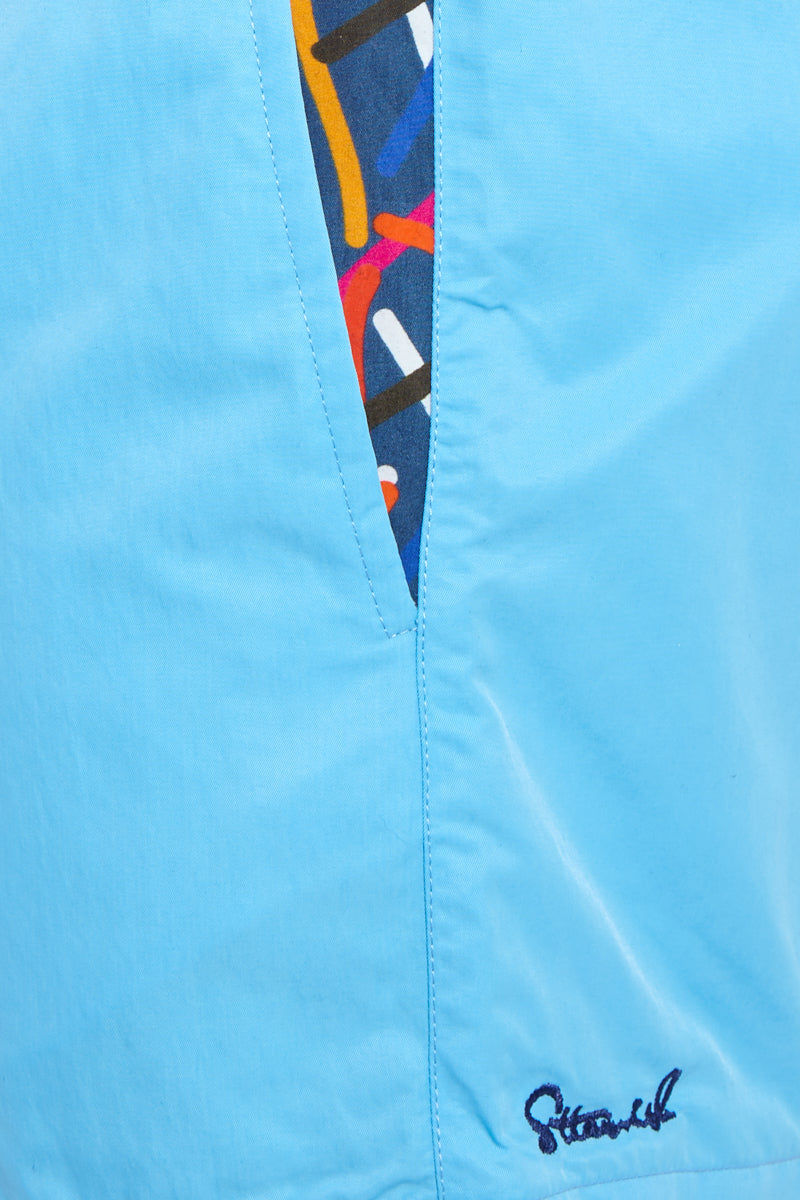 STTARWISH Ula Classic Length Swim Trunks - Aqua Blue Red Pop Art Mens Swim | Aqua Blue Red Pop Art| Ula Classic Length Swim Trunks - Aqua Blue Red Pop Art. Detailed View. Classic length. Two side angle pockets. Zip pocket at back. Drawstring waist. Mesh net lining. Quick Drying.