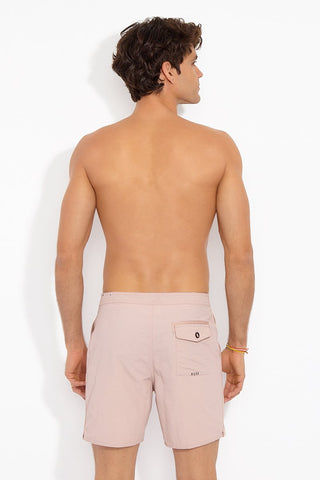 TAVIK MENS Catera Pockets Mid Length Swim Trunks - Rose Dust Mens Swim | Rose Dust| Tavik Mens Catera Pocket Mid Length Swim Trunks - Rose Dust. Back View. Dual front pockets. Concealed drawcord system. Inset elastic at waistband. Rear pocket with button closure. Webbing tape details.