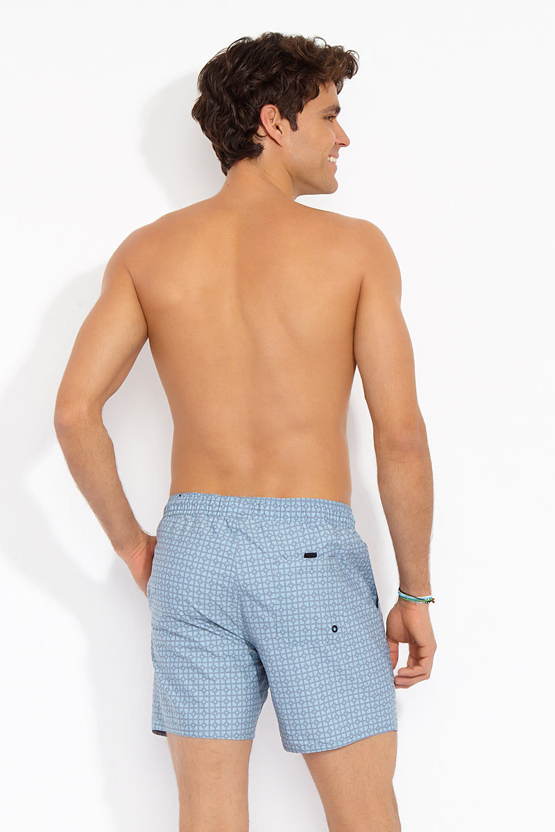 TAVIK MENS Belmont Pockets Mid Length Swim Trunks - Sea Mist Parker Mens Swim | Sea Mist Parker| Tavik Mens Belmont Pockets Mid Length Swim Trunks - Sea Mist Parker. Back View. Front Hand pockets. Elastic waistband. Branded speckled drawcord. Rubberized trims. Rear pocket with Velcro closure. Reinforced seat seam for max durability. Lightweight microfiber finished with a garment wash.