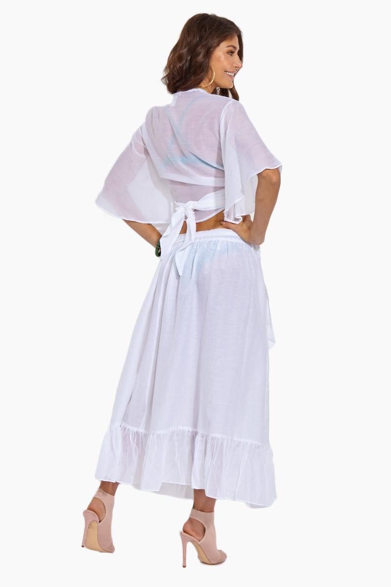 SOAH Chelsea Wrap Skirt - White Skirt   White Chelsea Wrap Skirt - Features:  Midi Wrap Skirt Ruffled Side slit Silk/ Cotton Blend Made in the USA Hand wash cold