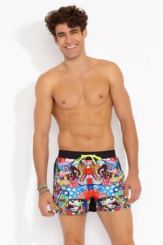 "J.LIN Runner Square Cut Swim Trunks - Graffiti Multicolor Print Mens Swim | Graffiti Multicolor Print| J. Lin Runner Square Cut Swim Trunks - Graffiti Multi Color. Front View. Shorter-length  Printed front panel  Two front forward seam pockets Back snap-fastening flap pocket  Elastic waistband  Drawstring with white mesh lining  Loose fit leg opening  100% Polyester  Model wears a M. Model measures 34"", height 6'1""/185cm."