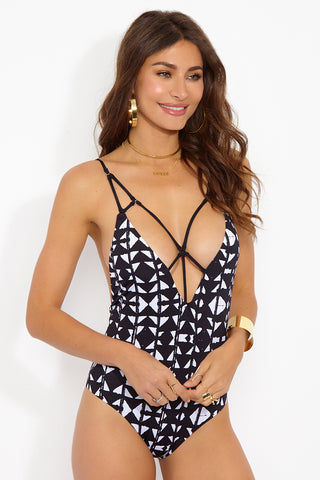 DOLCE VITA Cage Front One Piece Swimsuit - Punk Zulu One Piece | Punk Zulu| Dolce Vita Cage Front One Piece Back View. Features: Strappy front cut out one piece swimsuit in black and white abstract geometric print. Crisscross strappy detail at the front exposes cleavage through large cut outs. Mid-rise leg cut elongates your legs while keeping your hips partially covered. Thin shoulder straps plunge down the sexy open back to show off your shoulders. Fully lined to ensure opacity and to provide a comfortable fit. Front View