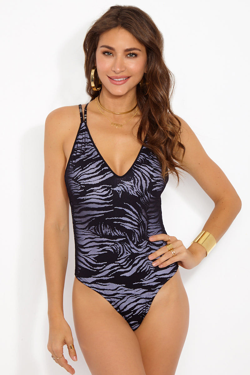 PRISM Mykonos Deep-V One Piece Swimsuit - Zebra Mesh One Piece | Zebra Mesh| Prism Mykonos One Piece Front View Features:  Plunging neckline  Double straps that cross over in the back  High cut let  Moderate coverage