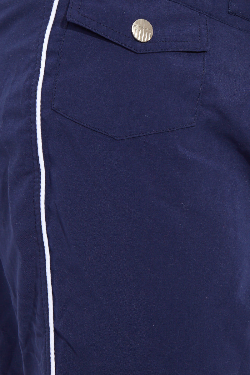 J.LIN Sailor Mid Length Swim Trunks - Classic Navy Mens Swim | Classic Navy| J. Lin Sailor Swim Sailor Mid Length Swim Trunks - Classic Navy. Detailed View. Mid-length  Buckle closure at center front  Forward seam with white pipping Snap front pocket, open back pocket White stretch lining   100% Polyester