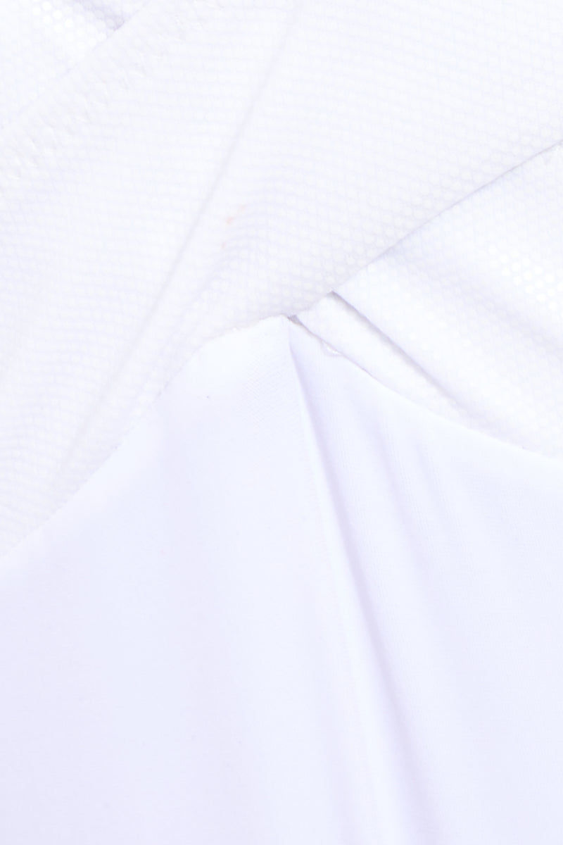 OYE SWIMWEAR Roman Plunge One Piece Swimsuit - White One Piece   White Oye Swimwear Roman Plunge One Piece Swimsuit - White. Features: White deep plunging OYE Roman Plunge One Piece with criss-cross bands that enhance the waistline Front View