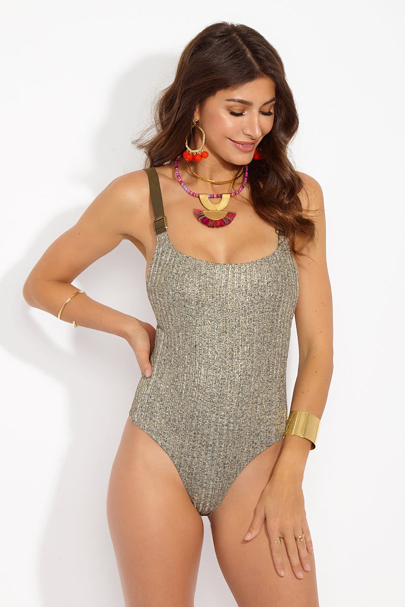 BLUE LIFE Buckled Overall One Piece Swimsuit -Tarnished Gold One Piece | Tarnish Gold| Blue Life Buckled Overall One Piece - Tarnished Gold Front View Metallic Ribbed One Piece  Side Boob Exposure  Adjustable Buckle Shoulder Straps High Cut Leg Thong Coverage  Spandex/ Nylon Blend  Made in USA  Hand Wash