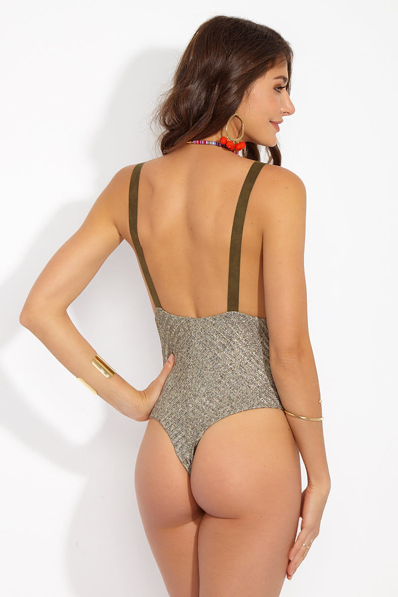 BLUE LIFE Buckled Overall One Piece Swimsuit -Tarnished Gold One Piece | Tarnish Gold| Blue Life Buckled Overall One Piece - Tarnished Gold Back View Metallic Ribbed One Piece  Side Boob Exposure  Adjustable Buckle Shoulder Straps High Cut Leg Thong Coverage  Spandex/ Nylon Blend  Made in USA  Hand Wash