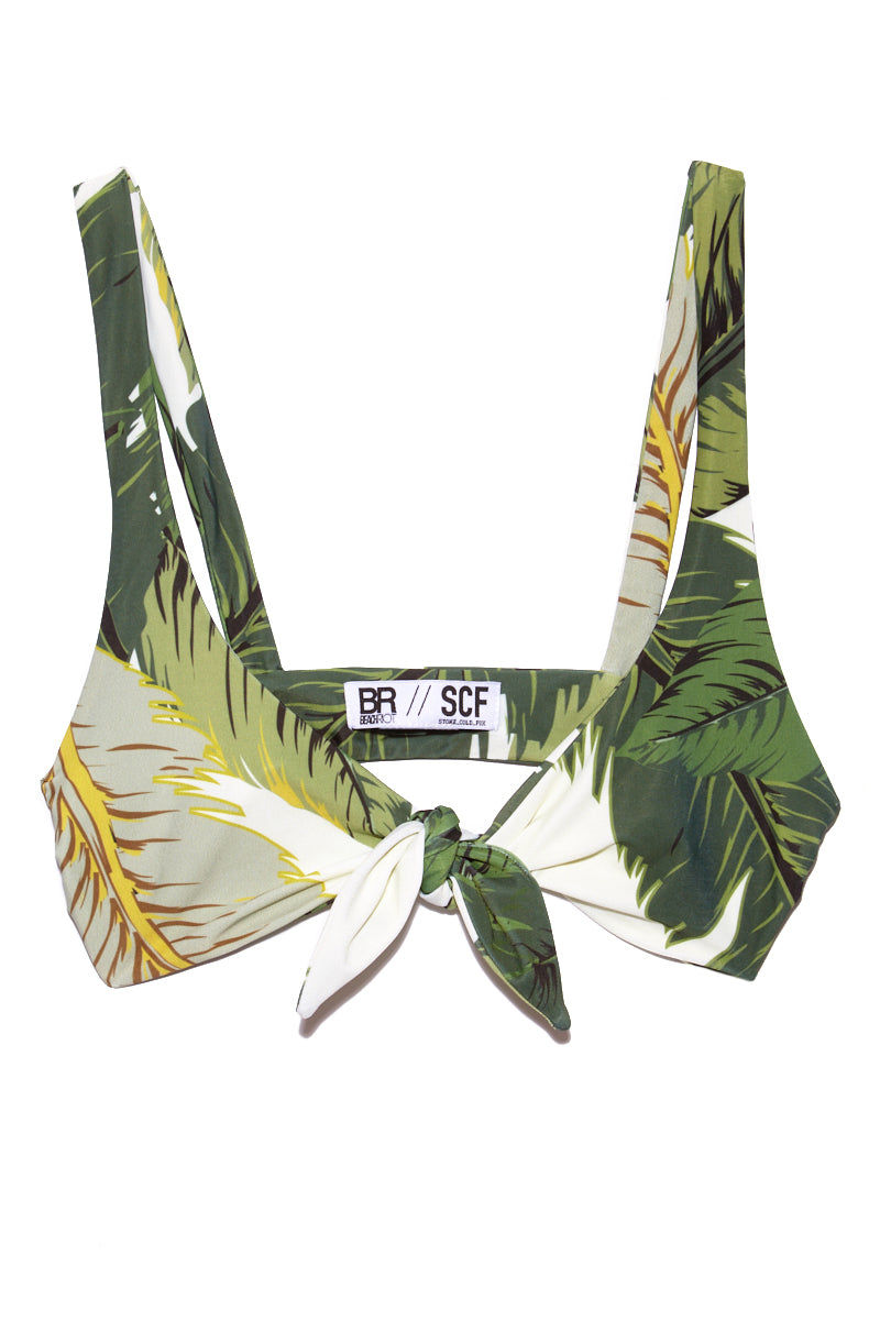 BEACH RIOT Grace Front Knot Bikini Top - Palm Bikini Top | Palm| Beach Riot Grace Front Knot Bikini Top - Palm. Flat Lay View. Front Knot style bikini top. Olive green color palm leaves print. Front tie closure.
