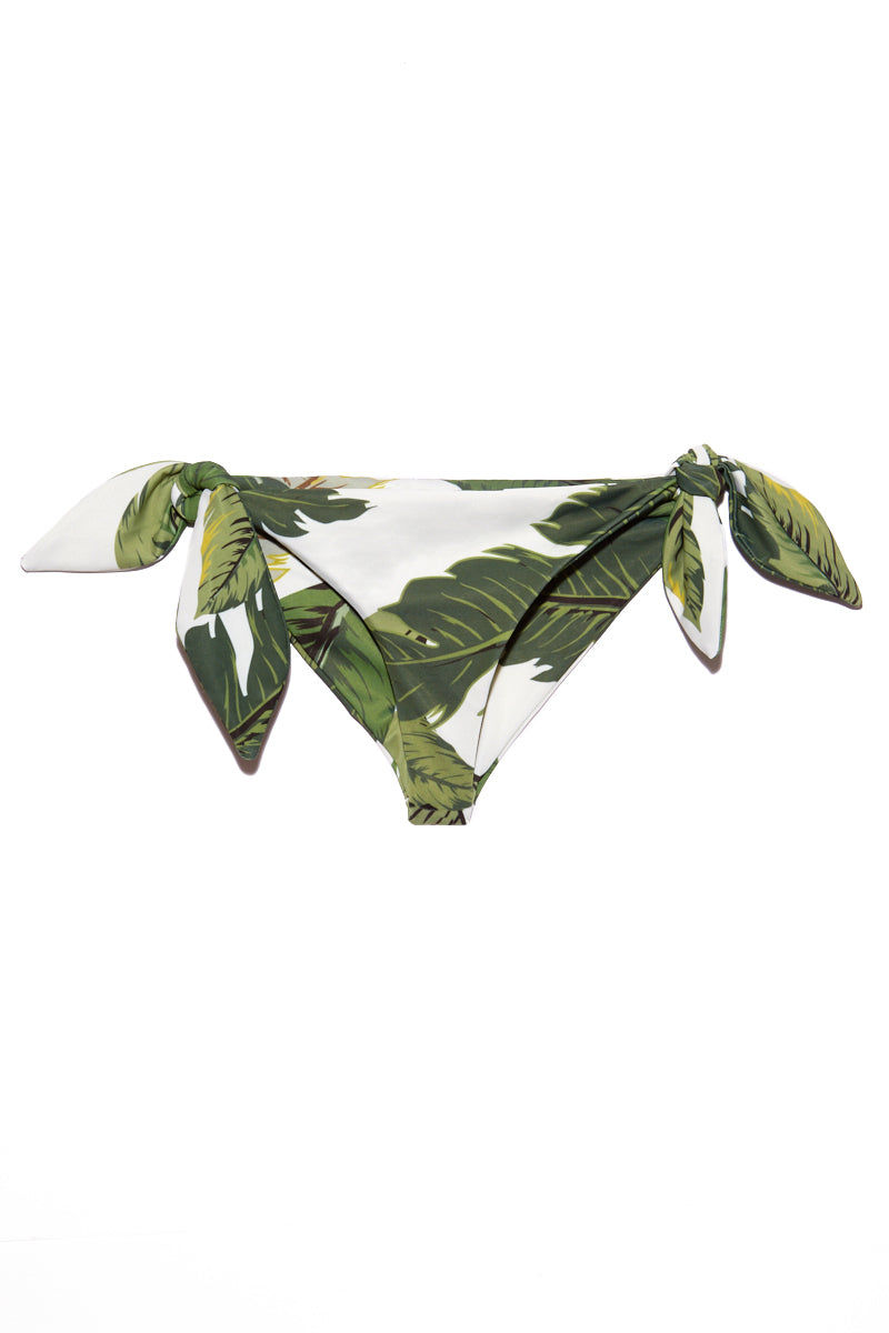BEACH RIOT Jacey Side Knot Bikini Bottom - Palm Bikini Bottom | Palm| Beach Riot Jacey Side Knot Bikini Bottom - Palm. Flat Lay View. Tropical print bikini bottom. Side knot detail. Olive green color palm leaves print. Moderate coverage mid rise.