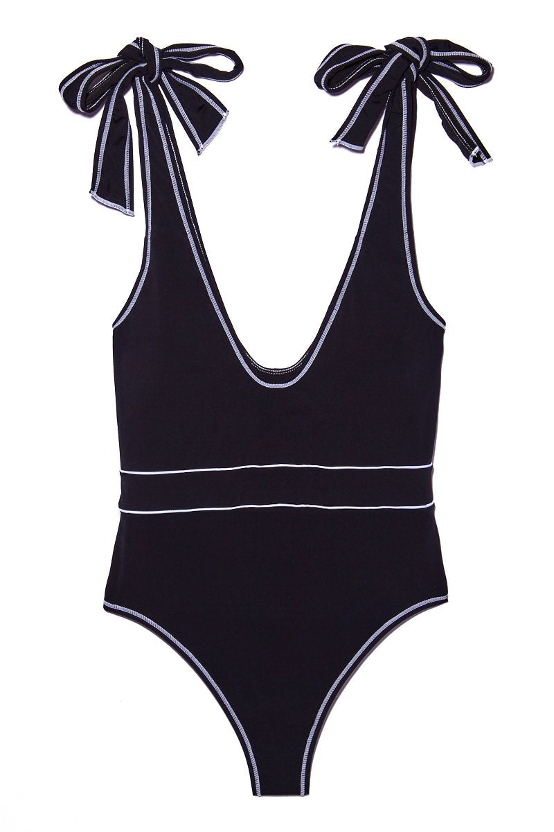 BEACH JOY Tie Shoulder One Piece - Licorice One Piece | Licorice|Tie Shoulder One Piece Flat Lay View. Features:  Black plunging one piece Adjustable string tie shoulder style Belt-like white lines at middle Cheeky style butt Minimal coverage