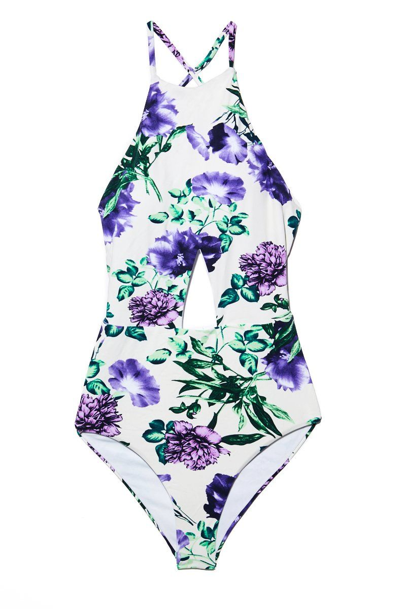 BEACH JOY High Neck Cut Out One Piece - Sweet Purple Bloom Print One Piece | Sweet Purple Bloom Print| High Neck Cut Out One Piece - Sweet Purple Bloom Print . Flat Lay View. Crisscross back string detail. Cut out in the middle Moderate Coverage. Purple floral high neck one piece.