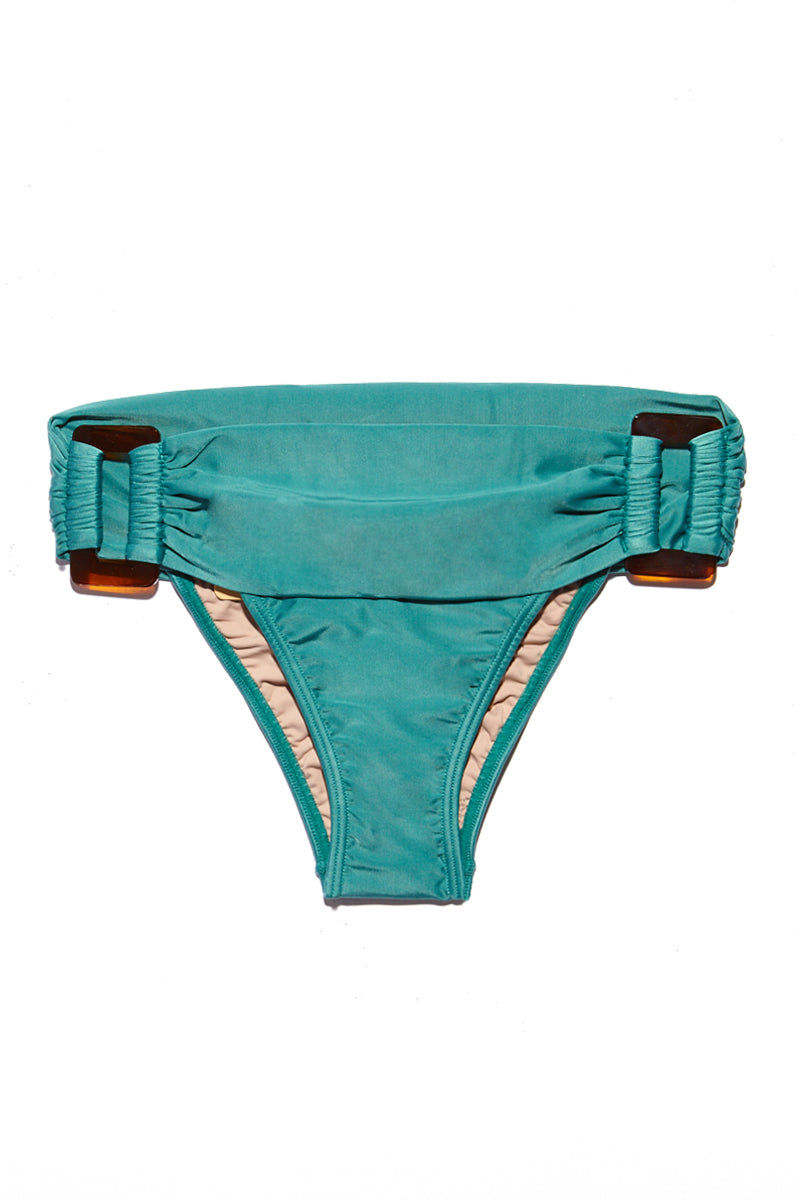 ADRIANA DEGREAS Low Rise Fold-Over Buckle Brief Bikini Bottom - Blue Heritage Bikini Bottom | Blue Heritage|Adriana Degreas Buckle Bikini Bottom - Blue HeritageFeatures:  Cheeky bikini bottom Buckle hardware with scrunch detail at sides Tropical teal color Flatlay View