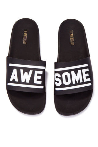 THE WHITEBRAND Awesome Minimal Slides (Men's) - Black Mens Sandals | Black|WHITEBRAND Awesome Minimal Slides (Men's)- Black Features: Men's flat slide sandal in black Made of PVC Black mesh vamp Horizontal stripes are attached and the word AWESOME in black rubber 3cm high ergonomic lightweight sole