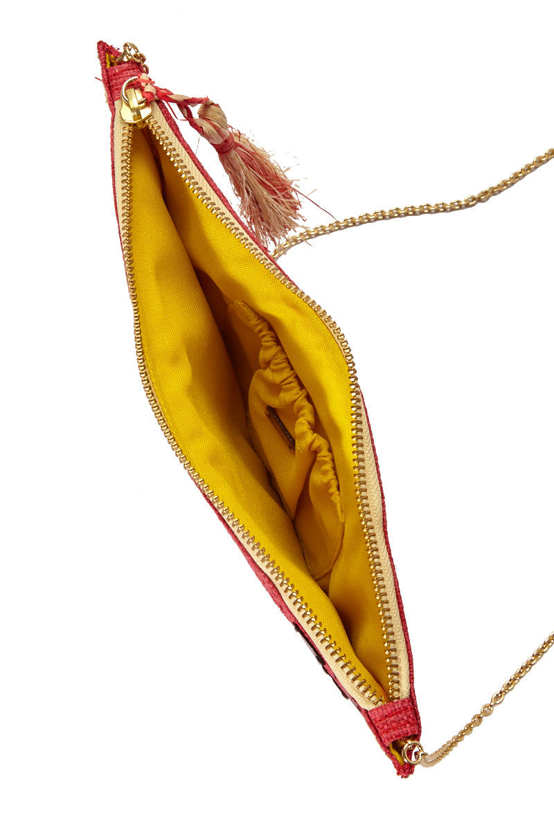 "KAYU Frutta Pouch - Watermelon Bag | Watermelon| Kayu Fruta Pouch - Watermelon  Raffia embroidery to look like a watermelon slice  Zipper Closure Tassel detail Shell embellishments  Optional chain strap  Yellow interior  Easily fits standard size cellphone Measurements: 11"" W x 6.5"" H"