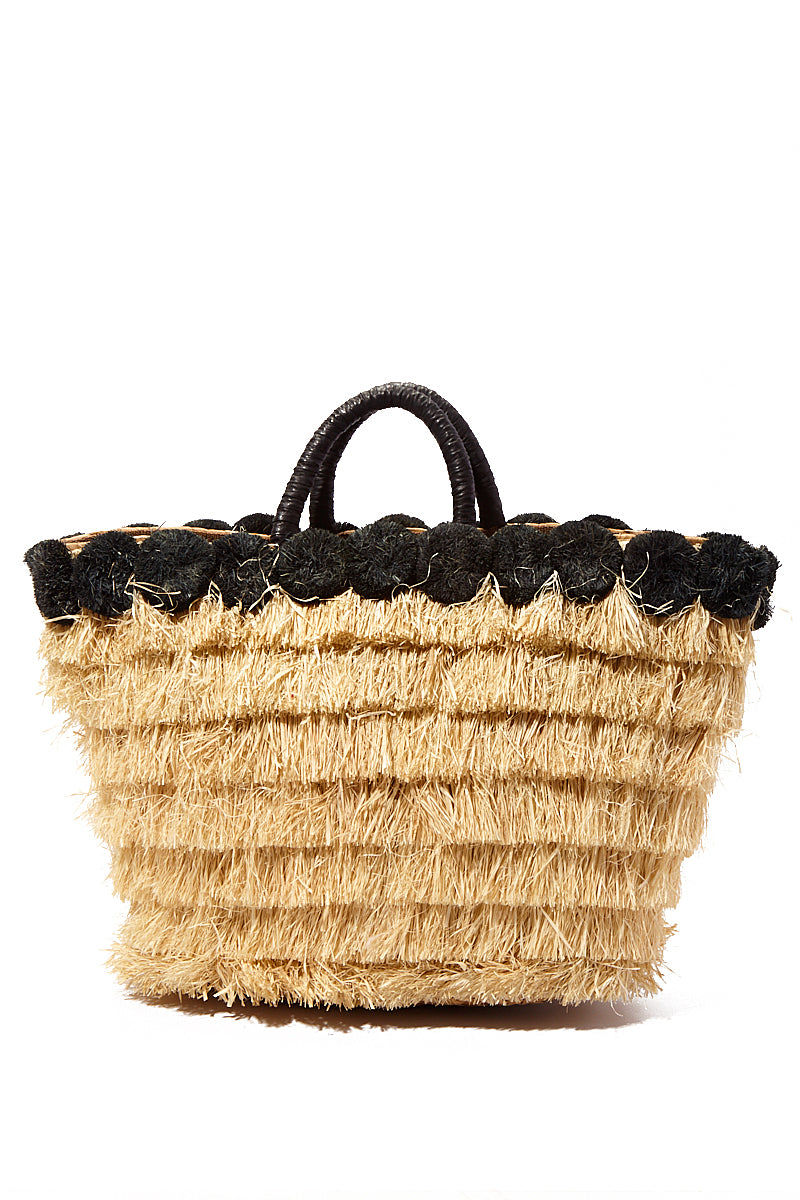 "KAYU Lucca Raffia Tote - Black/Natural Bag | Black/ Natural| Kayu Lucca Raffia Tote Front View Raffia fringe body  Raffia pom poms   Leather handle  A drawstring lining keeps your belongings safe  Roomy enough for all of your essentials  Measurements: 16"" W x 12"" H x 5"" D"