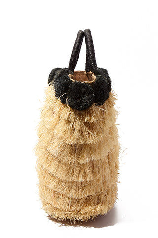 "KAYU Lucca Raffia Tote - Black/Natural Bag | Black/ Natural| Kayu Lucca Raffia Tote Side View Raffia fringe body  Raffia pom poms   Leather handle  A drawstring lining keeps your belongings safe  Roomy enough for all of your essentials  Measurements: 16"" W x 12"" H x 5"" D"
