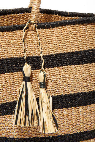 "KAYU Mare Stripe Tote Bag | Natural Stripes| Kayu Mare Stripe Tote Close Up View Striped Tote Made out of woven abaca Features coordinating raffia tassels Roomy enough for all of your essentials.  Measurements: 16.5"" W x 10.5"" H x 5"" D"