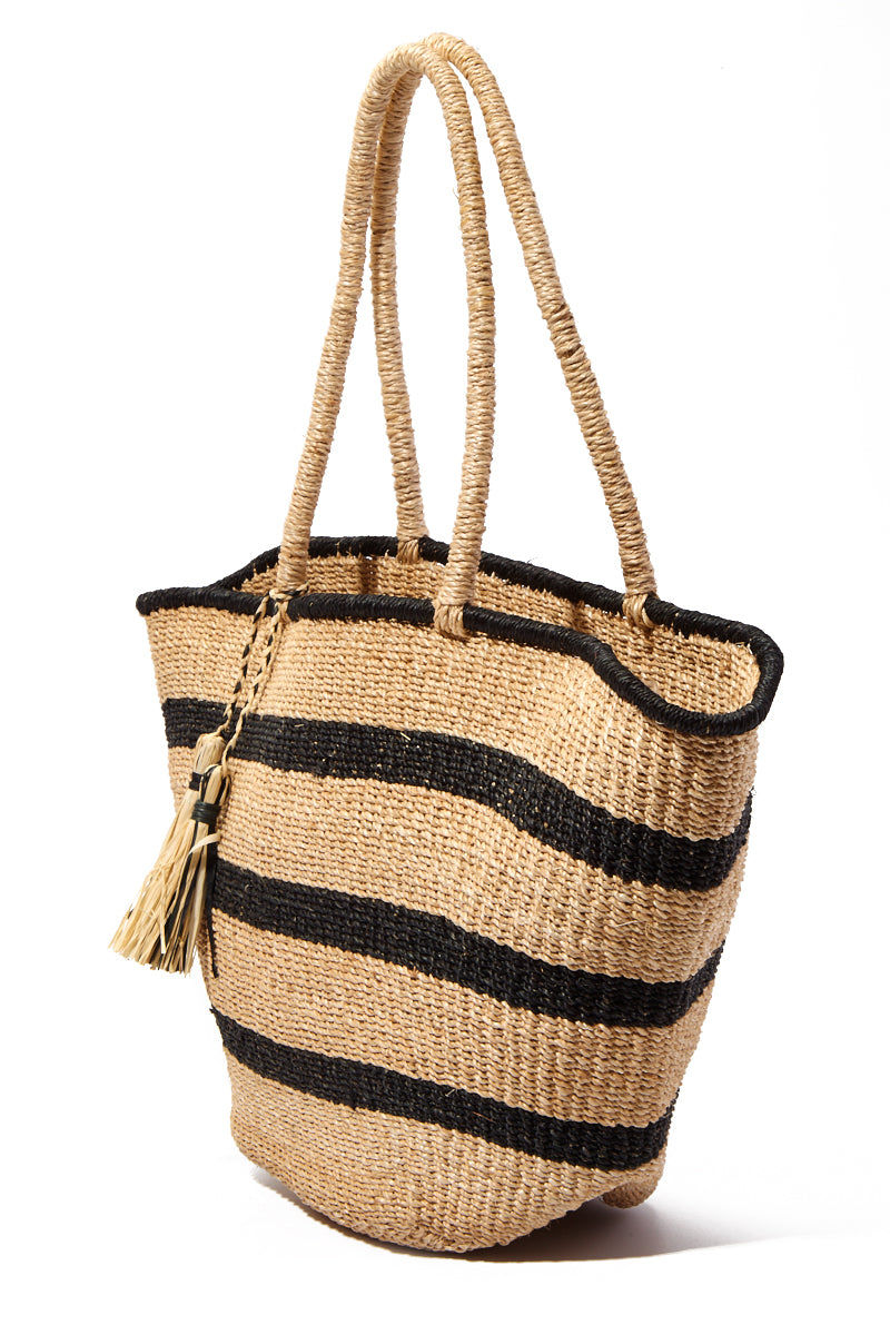 "KAYU Mare Stripe Tote Bag | Natural Stripes| Kayu Mare Stripe Tote Side View Striped Tote Made out of woven abaca Features coordinating raffia tassels Roomy enough for all of your essentials.  Measurements: 16.5"" W x 10.5"" H x 5"" D"