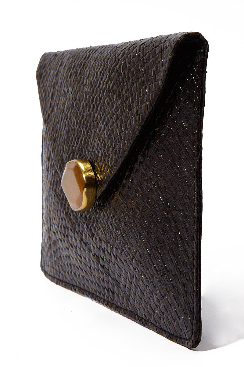 KAYU Capri Envelope Clutch Bag | Black| Kayu Capri Envelope Clutch Side View Envelope clutch  Handwoven natural straw and topped with a glimmering natural agate Optional drop-in chain strap Easily fits standard size cellphone