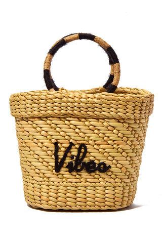 "POOLSIDE Mini Straw Tote - Vibes Bag | Black/Natural/Black| Poolside vibes The Mak Embroidered Straw Small Bag Handmade in India using 100% water reed Textured straw design Dual top round wooden handles Open tote Black embroidery - Vibes Height to top of handle: 11"" Height of bag: 7"" Length: 10"" tapering to 6"" Width: 3"""
