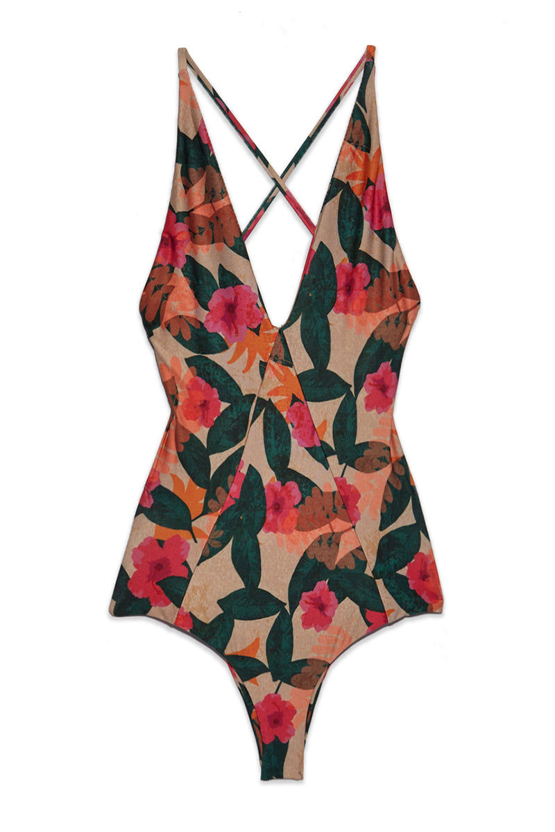 STONE FOX SWIM Palma Plunging Open Back One Piece Swimsuit - La Buena One Piece | La Buena| Stone Fox Swim Palma One Piece - La Buena Flatlay View Plunging V-Neckline  Strappy Side Cutouts  Low Scoop Back Criss Cross Back Straps Moderate Coverage Fully lined  80% Nylon, 20% Spandex